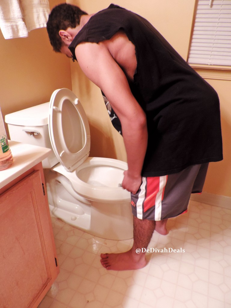 son cleaning the toilet