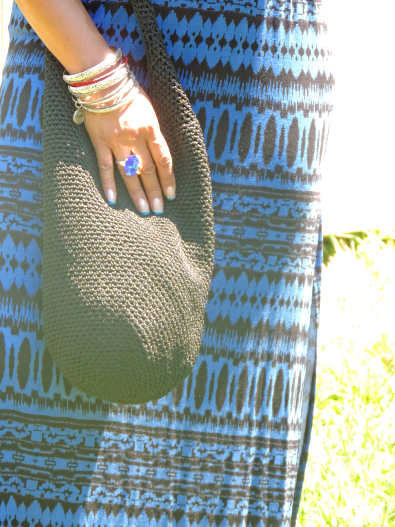 Boho bag, statement ring and armful of bangles